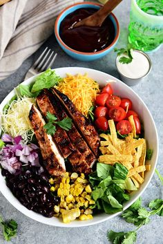 This BBQ Chicken Salad is super easy and off the hook delicious! Grilled corn and lime crema really make it sing! If you're a fan of Panera's BBQ Chicken Salad, you're going to love this copycat salad you can make in 15 minutes or less! Print the full recipe at TidyMom.net