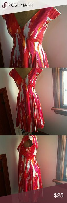 Calvin Klein size 4 rockabilly remake dress Size 4 Rockabilly remake dress white red and orange tones. Zip closure in back, cap sleeves,only flaw is some stitching work in front by  bust. This is a thick heavy beautiful material... absolutely gorgeous Calvin Klein Dresses Midi