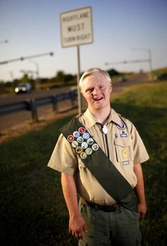 Boy Scout Josh Kuykendall, 16, stands near State Highway 74 and Waterloo Road.