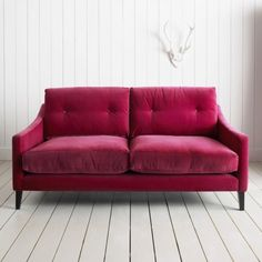 So inviting. Fuchsia love seat.