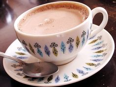 Protein Hot Chocolate 1/2 c coffee (you can skip coffee) 1 cup almond milk, unsweetened 1/3 c water **combine on stovetop on medium heat** add 1 scoop Genepro **whisk until dissolved** add 1 TBLSP unsweetened cocoa powder **whisk until dissolved** Add 1/2 TBLSP truvia a pinch of salt a dash of cinnamon 1/2 tsp vanilla