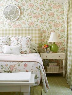 Scale Matters.  Scale and rhythm are key principles to successful pattern-mixing. In a space filled with pretty florals, an oversize-gingham fabric on the upholstered headboard and drapes offers a welcome contrast. The orderly pattern of green-and-white checks introduces a steady rhythm to the free-flowing florals on the walls and bedding. A larger-scale gingham pattern ensures that the fabric isn't lost among the room's elements the way a smaller pattern could have been
