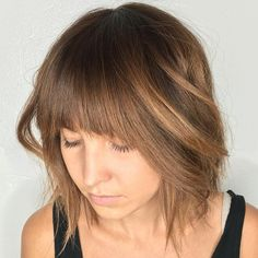 Medium Shaggy Hairstyle With Arched Bangs