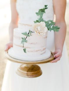 Floral accented naked cake: http://www.stylemepretty.com/little-black-book-blog/2016/01/07/organic-scarborough-bluffs-beach-wedding-inspiration/ | Photography: Katie Nicolle - http://www.katienicollephotography.com/