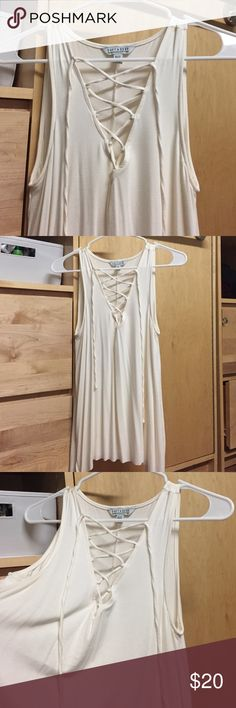 Lace up flowy tank top American eagle cream lace up flowy tank top. Never worn. American Eagle Outfitters Tops Tank Tops
