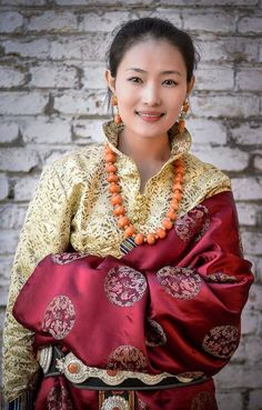 Tibetan woman in traditional festive costume of her region. with traditional jewelry