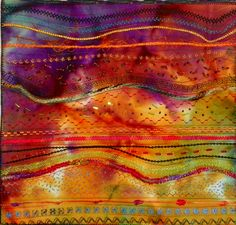 Eye Candy - couched fibers, free motion machine embroidery stitches, hand beading.