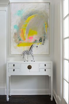 In her Weston, Connecticut, home, the artist creates a blank canvas for displaying her self-made paintings.