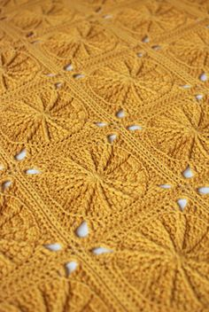 crochet blanket. I like the look of this and how the centers aren't so open so it would be extra warm and toasty.
