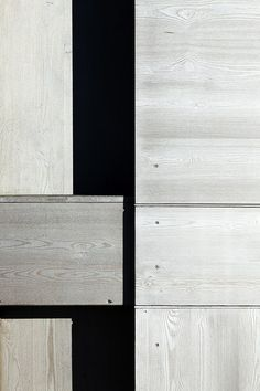 """Detail: Wardrobe in the landscape, a micro weekend retreat consisting of a small wooden """"box"""" building fitting between 2 existing buildings by Enrico Scaramellini Architetto."""