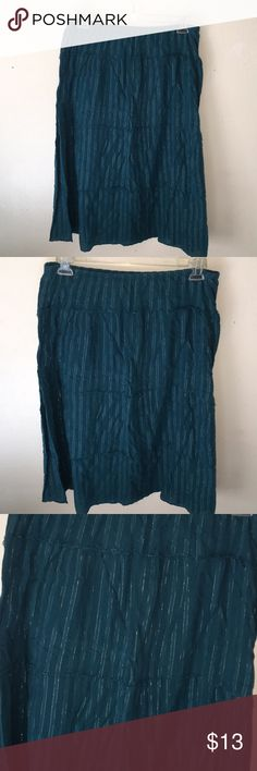 Beautifully Designed Skirt This skirt is so comfortable and is my favorite it's more of a teal color with gold lining designed on the front and back of the skirt. There is a lining underneath as well. Perfect to wear for a work environment, a casual event, or a day out . Great condition L: 31 inches Uno Core Skirts