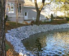 Rip-rap is the placement of large rocks or coarse stone along the water's edge of a bank or shoreline to accomplish erosion control.…