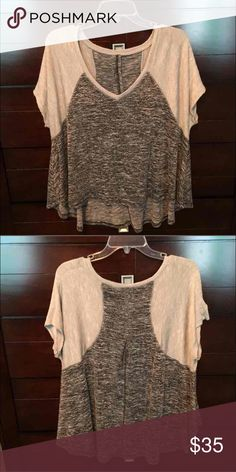 Free people flowy top Cute marled grey trapeze free people top. The free people tag on the shirt came off in the wash, but it is a size medium and authentic free people. Very flowy top, super cute on. No flaws that I can find.  🌸BUNDLE AND SAVE  🌸NO TRADES 🌸REASONABLE OFFERS CONSIDERED  🌸FEEL FREE TO ASK QUESTIONS 🌸I DO NOT MODEL Free People Tops Tees - Short Sleeve