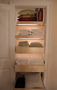 Pull out drawers in linen closet