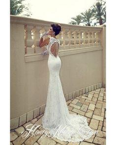 Умопомрочительное свадебное платье из дорогого  кружева, с сексуальным вырезом на спине!