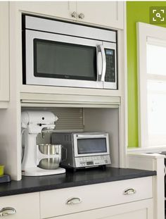 A Busted Open Brightened Up Kitchen - Microwaves - Ideas of Microwaves - A niche for the microwave gives it a built-in look. The custom appliance garage has its own outlets and a stainless-steel roll-down door. Kitchen Appliance Storage, Appliance Garage, Kitchen Cabinet Storage, Kitchen Cabinet Design, Kitchen Redo, Kitchen Pantry, Kitchen Appliances, Kitchen Ideas, Retro Appliances