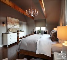 rustic chic, chalet style, linen drapery, fur pillows, wood bed, white bedside tables, greige walls, wood beams, painted chandelier