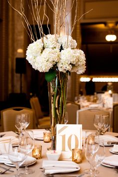 Beautiful hydrangeas for centerpieces. View the full wedding here: http://thedailywedding.com/2016/06/26/golden-glam-wedding-kat-stu/