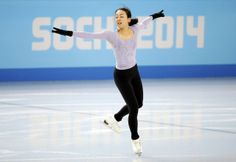 Asada of Japan practices during a figure skating training session in preparation for the 2014 Sochi Winter Olympics at the Iceberg Skating P...