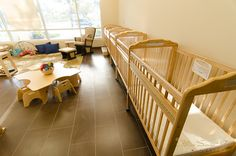 The Infant classroom at Global Village Preschool. Ratio: 1 teacher per 4 students with a total of 8 students in the classroom. Each child has their own crib for naps and lots of room to enrich movement and gross motor skills such as rolling over, sitting up unassisted, crawling, and walking! #GVP