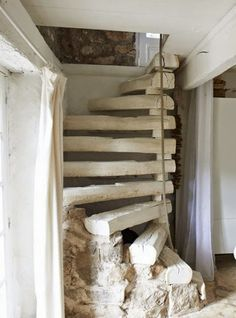 DIY rustic spiral staircase. This looks like something that would have gone into an old gold mine...