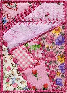 This is a gorgeous little mini quiltie measuring 3 x 4 (inches). It has Peltex in the middle for a stabilizer and is signed on the back. I think this