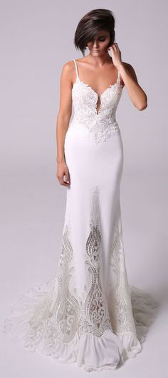 skin tight mermaid gown with a plunging V neckline and a low back at the behind marriage of two embroidered laces fit and flare wedding dress : Michal Medina #weddingdress #weddingdresses