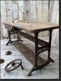 Singer sewing machine upcycled into a writing desk by Quirky Interiors.  Love it!