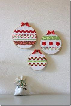 Embroidery hoops ? Christmas tree baubles...decorate a cardboard bauble shape with strips cut from patterned paper...good cutting practice I need some embroidery hoops :/