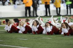 New York Jets cheerleaders lie on the field during a timeout during the first half of an NFL football game, Sunday, Dec. 23, 2012 in East Rutherford, N.J. (AP Photo/Bill Kostroun)