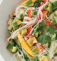 Thai Noodle Salad - The tangy coconut lime dressing in this cool and colorful Thai rice noodle salad goes hand in hand with naturally sweet mango and red bell pepper.