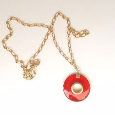 "Banana Republic necklace Banana Republic necklace. Gold with red/orange acrylic circle pendant. Chain is 30"" long, and the pendant is less than 2"" across. Great way to add a pop of color to an outfit! Banana Republic Jewelry Necklaces"