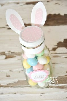Easter Mason Jar With Bunny Ears Gift Idea and Tutorial. Easter gift ideas - DIY idea for adults and children to make. Easy to follow projects for painting mason jars, filling them with Easter eggs, chocolates and sweets. Great as homemade gifts for teachers, parents and children. #Easter #EasterEggs #EasterCrafts #MasonJars #MasonJarCrafts