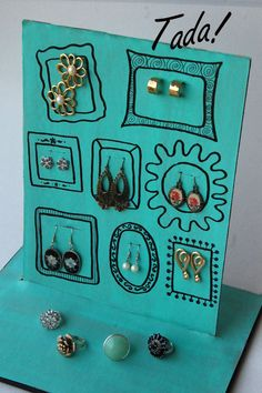 old cardboard made into earring display - blah to TADA!: An Array of Earrings