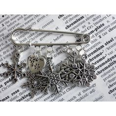 Thread Squirrel Personalised Snowflake Christmas Brooch Pin (£15) ❤ liked on Polyvore featuring jewelry, brooches, pin jewelry, snowflake brooch, christmas charms, snowflake jewelry and snowflake charm