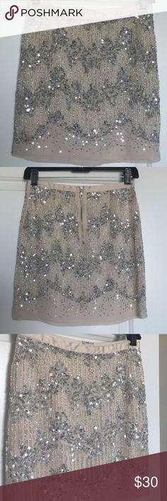 H&M mini beaded sequin skirt This glamorous cream mini skirt with silver sequins and beading is a must-have for the holiday season! No flaws, doesn't fit me. H&M Skirts Mini