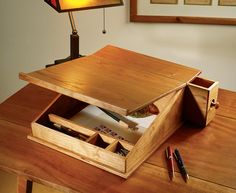 http://www.popularwoodworking.com/articleindex/portable-writing-desk