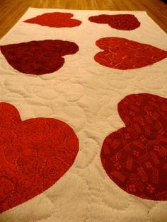 Valentine and St Patrick's Day table runner by Covequilter on Etsy, $30.00