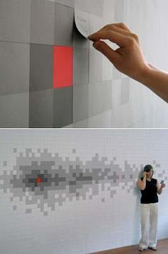 The red wall is covered in four layers of post-it notes to create a design as you use them. How fun!