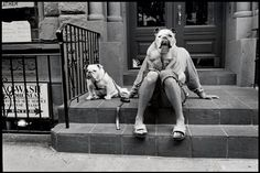This photo is taken by Elliot Erwitt. He is well known for his juxtaposition. This photo is great! The way the dog is sitting on his owners lap makes it look like the dog has real arms and legs!