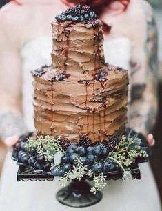 Tree bark Belgium chocolate drip cake with blueberries and currants for a winter woodland wedding.