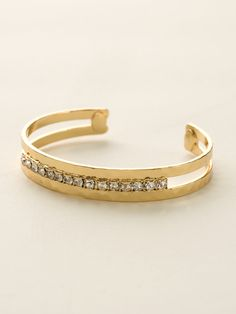 Stacking done for you! This unique cuff features a row of rhinestone crystal set between two thin, hammered metal cuffs. All Sorrelli jewelry is covered by our exclusive Lifetime Warranty!