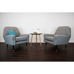 1960s Armchairs reupholstered in a grey wool. You can find them here at http://www.johnnymoustache.com/our-collection/vintage-furniture/1960s-sofa-203.html#