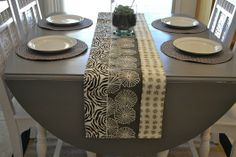 great tutorial on how to restain your dining room table with a gray stain. love it & those chairs.