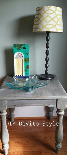 Side table painted in Annie Sloan Duck Egg Blue and a mix of Old White and Graphite with dark wax.  www.facebook.com/diydevitostyle