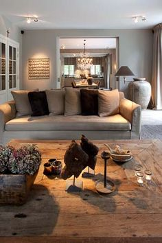 Large coffee table or alternatively an upholstered ottoman used to place magazines, coffee table books and trays for drinks.