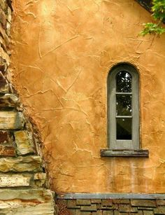 window + rough stucco exterior of 'sunwise turn' cottage, carmel-by-the-sea | architectural details