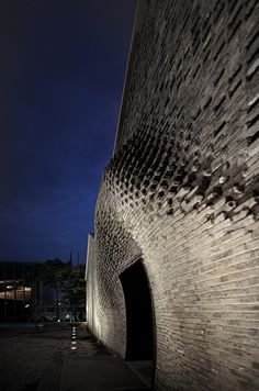 Arch-Union Architects used robots programmed to place bricks in the correct positions to create the complex design for the exterior of this arts center in Shanghai, China.  - photo by Shengliang Su and Bian Lin, via dezeen