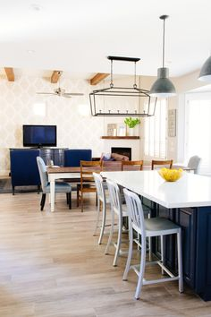 From the the designers... This project involved a full remodel of a kitchen that included taking the kitchen down to the studs and ripping and replacing the flooring throughout the whole house.  This space started as a dark and dated kitchen that was filled with over 50 rooster figurines.  We