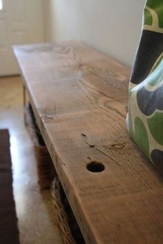 """Angela Ferdig of Kriselkeeper recently posted on her DIY entryway bench project, which was """"inspired by the Nakashima table in Steal This Look: Julian Bench With Storage, Storage Baskets, Diy Bench, Bench Seat, Storage Drawers, Mudroom Cubbies, Reclaimed Wood Benches, Wood Planks, Diy Wood Projects"""